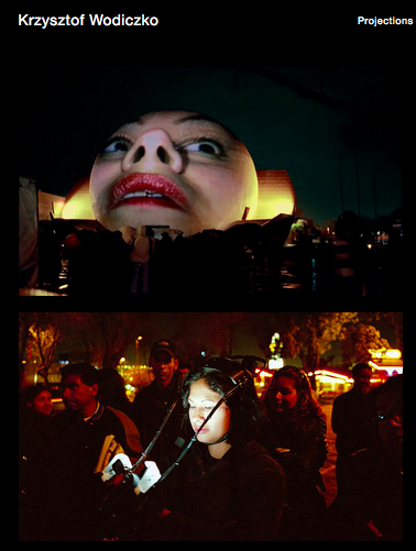 screen shot of someone's face projected live on to the side of a spherical building, wearing a camera and light, their face distorted by the shape of the projection and the lens distortion of the camera.
